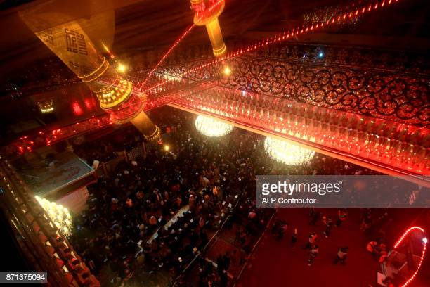 Shiite Muslim pilgrims gather the Immam Abbas ibn Ali shrine in the southern Iraqi city of Karbala on November 7 2017 ahead of the Arbaeen religious...
