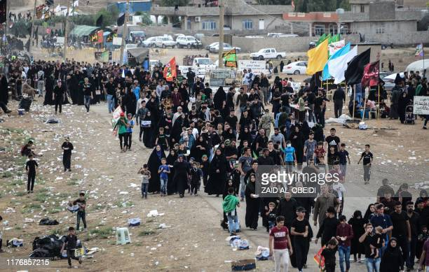 Shiite Muslim pilgrims march towards the shrine of Imam Zein alAbdedin in Bartalla in the northern Iraqi Nineveh province on October 19 2019 to mark...