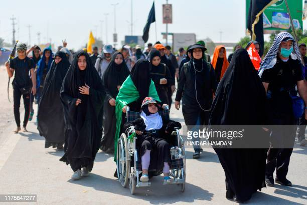 Shiite Muslim pilgrims pass through the holy Iraqi city of Najaf on October 14 on their way to the central shrine city of Karbala ahead of the...