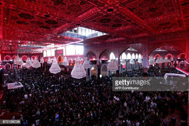 TOPSHOT Shiite Muslim pilgrims pray during the Arbaeen religious festival on November 4 in the holy Iraqi city of Karbala 50 miles south of Baghdad...