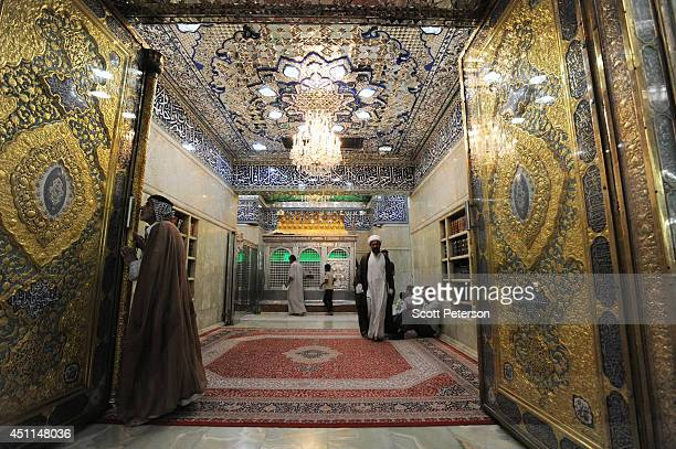 Shiite Muslim pilgrims visit the tiled shrine and gilt inner sanctum of a disciple of Imam Hussein a grandson of Prophet Mohamed and Shia Islam's...