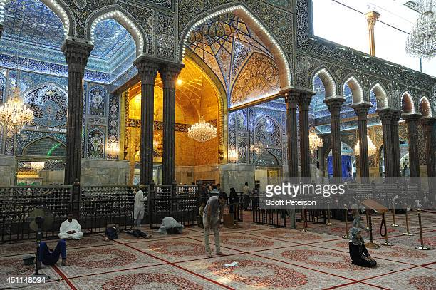 Shiite Muslim pilgrims visit the tiled shrine and gilt inner sanctum of Imam Hussein a grandson of Prophet Mohamed and Shia Islam's third and most...