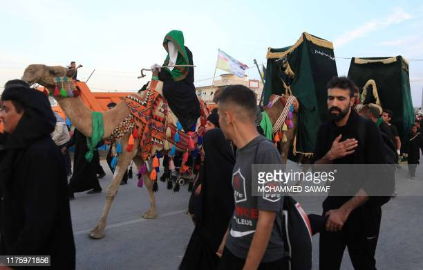 Shiite Muslim pilgrims walk in the holy Iraqi city of Karbala on October 14 ahead of the Arbaeen religious festival Shiite Muslim pilgrims continued...