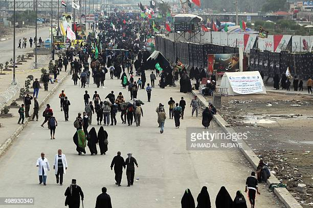 Shiite Muslim pilgrims walk on a road in Baghdad's Dora district on November 27 on their way to the Iraqi holy city of Karbala to take part in the...