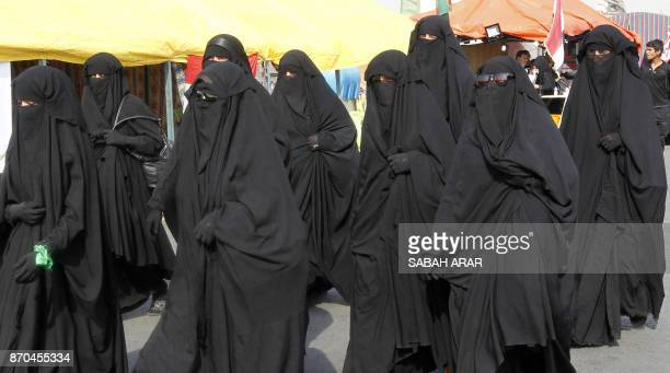 Shiite Muslim pilgrims walk on a road on the southern outskirts of Baghdad as they head towards the holy city of Karbala on November 5 2017 a week...