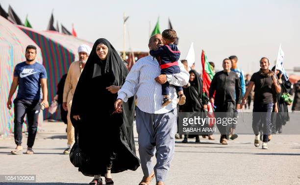Shiite Muslim pilgrims walk on the outskirts of the Iraqi capital Baghdad towards the central Iraqi shrine city of Karbala on October 27 ahead of the...