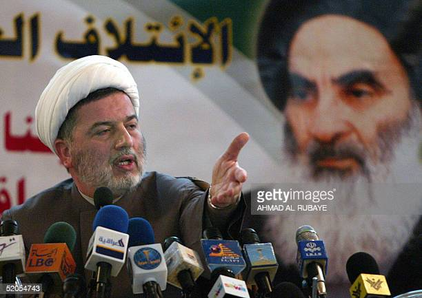 Shiite Muslim Sheikh Hamam Hamudi gestures as he talks during a press conference at the offices of the Supreme Council for the Islamic Revolution in...