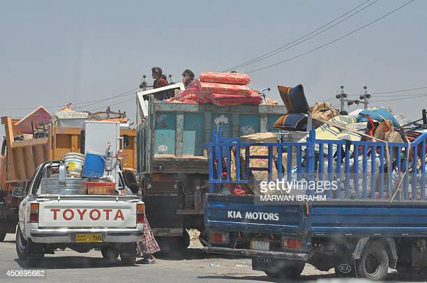 Shiite Muslim Turkmen families leave the village of Taza Khormato south of the oil hub city of Kirkuk in northern Iraq fearing any escalation in...