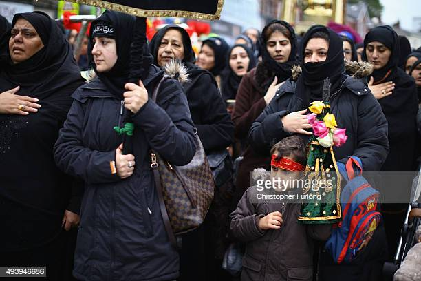 Shiite Muslim women take part in an Ashura procession on October 23 2015 in Manchester England Shiites across the world mark Ashura the tenth day of...