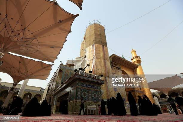 Shiite Muslim women walk in the courtyard of the Imam Ali Ibn Abi Taleb shrine in the Iraqi holy city of Najaf on January 23 2018