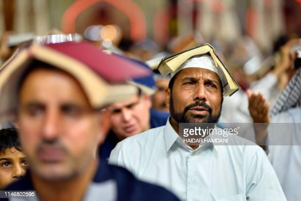 Shiite Muslim worshipperes gather for the ritual prayer of Lailat alQadr which marks the night in fasting month of Ramadan during which the Koran was...