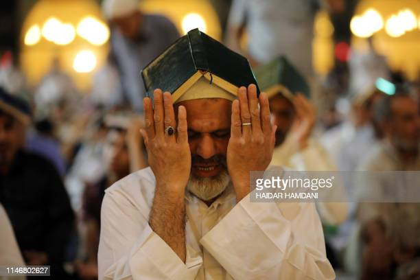 TOPSHOT Shiite Muslim worshipperes gather for the ritual prayer of Lailat alQadr which marks the night in fasting month of Ramadan during which the...
