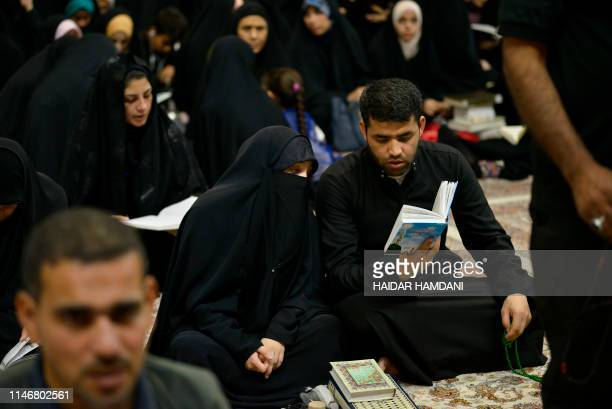 Shiite Muslim worshipperes read prayeres during Lailat alQadr which marks the night in fasting month of Ramadan during which the Koran was first...