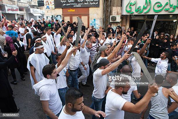 Shi'ite muslims, carrying swords and knives, during an Ashura Day commemoration in Nabatieh , Lebanon. Ashura Day is an annual festival amongst the...