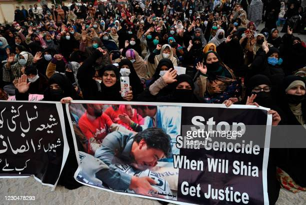 Shiite Muslims chant slogans and hold banners during a protest against the killing of miners of the Hazara Shiite community in an attack by gunmen in...