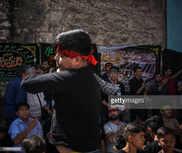 Shiite Muslims perform during the annual commemoration Ashura in Pireaus 20 September 2018 Hundreds of Shiite Muslims gathered in Piraeus to...