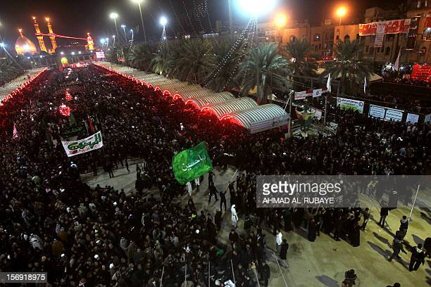 Shiite Muslims gather outside the shrine of Imam Abbas early on November 25 2012 in Karbala during the celebration of Ashura Millions of pilgrims...