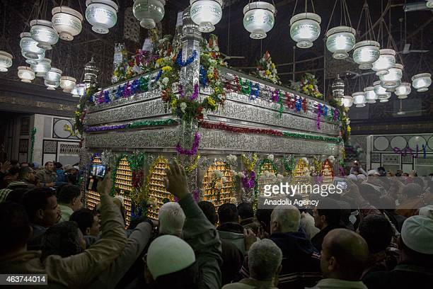 Shi'ite Muslims gather to pray as they believe the birthday of Imam Hussain, around the Husayn Mosque in Cairo, Egypt, on February 17, 2015.