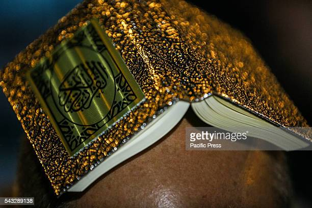 Shiite Muslims hold the Koran on their heads as they pray on Lailat alQadr which marks the night in which the holy Koran was first revealed to the...