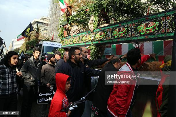 Shiite Muslims mourns during the mourning procession of Ashura on the 10th day of holy month of Muharram the first month of Islamic Calendar to...