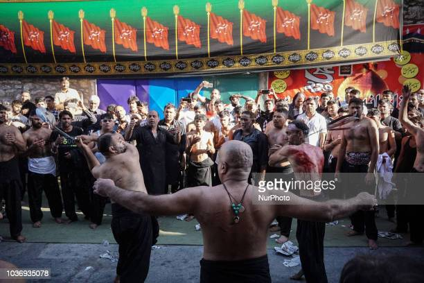 Shiite Muslims perform during the annual commemoration of Ashura in Pireaus 20 September 2018 Hundreds of Shiite Muslims gathered in Piraeus to...