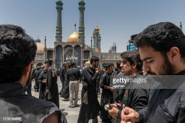 shiite muslims practice self-flagellation in the courtyard of the fatima masumeh shrine.  qom- iran. - shi'ite islam stock pictures, royalty-free photos & images