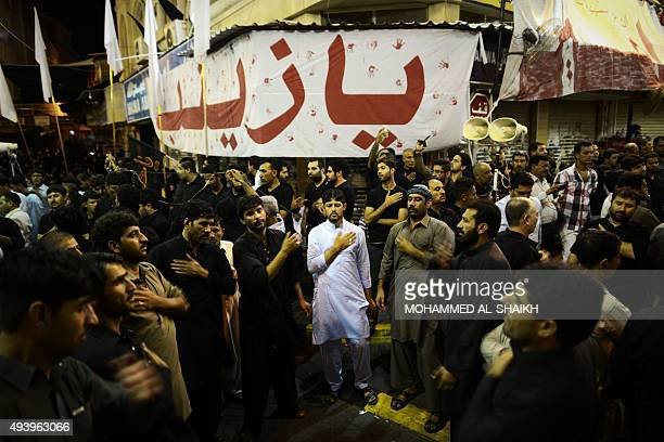 Shiite Muslims take part in a ceremony marking Ashura which commemorates the seventh century slaying of Imam Hussein the grandson of Prophet Mohammed...