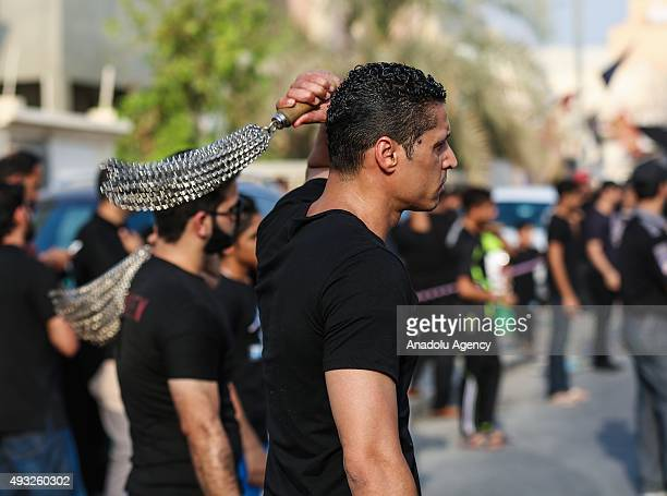 Shi'ite Muslims take part in the Muharram procession ahead of Ashura in Manama Bahrain on October 18 2015 Ashura which falls on the 10th day of the...