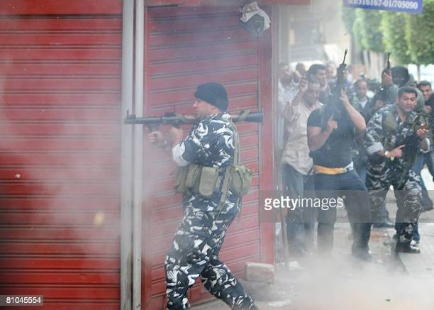 A Shiite opposition gunman fires a rocket propelled grenade during clashes with progovernment supporters in a street in Beirut on May 8 2008 Deadly...