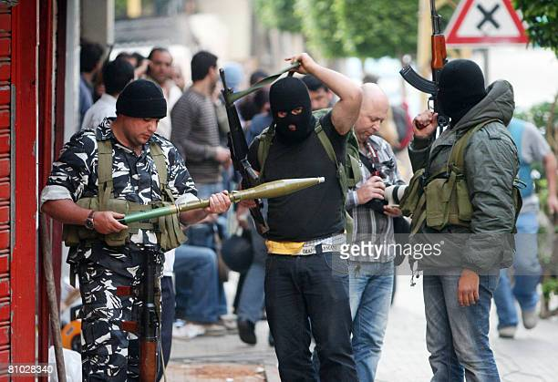 Shiite opposition militiamen check their weapons during clashes with progovernment supporters in a street in Beirut on May 8 2008 Deadly gunbattles...