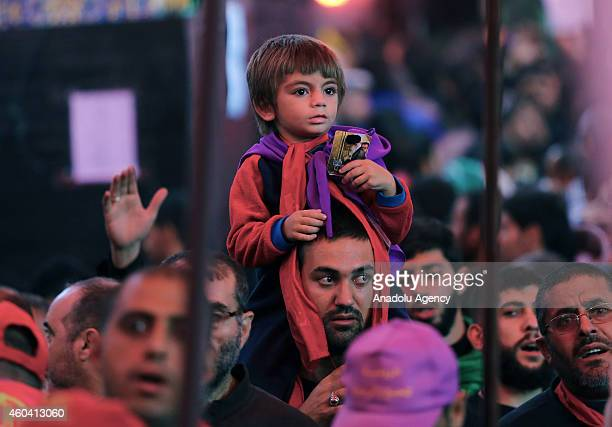 Shi'ite people gather at Imam Hussein shrine during the Arba'een ceremony in the holy city of Karbala southern Iraq on December 13 2014 Hundreds of...