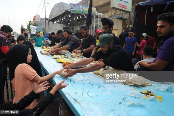 Shiite pilgrims are given food as they march to the shrine of Imam Hossein to commemorate arbaeen the fortieth day after the anniversary of the 680AD...