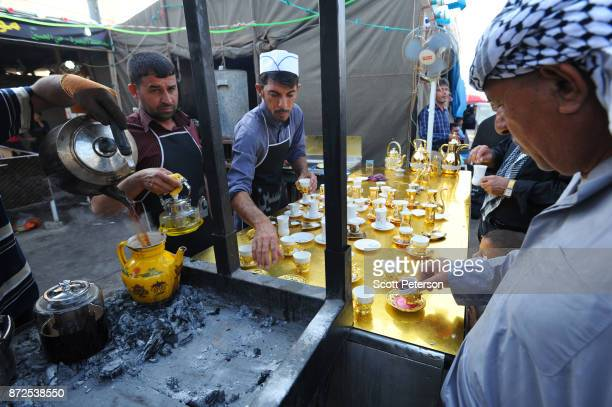 Shiite pilgrims are offered tea as they march to the shrine of Imam Hossein to commemorate arbaeen the fortieth day after the anniversary of the...