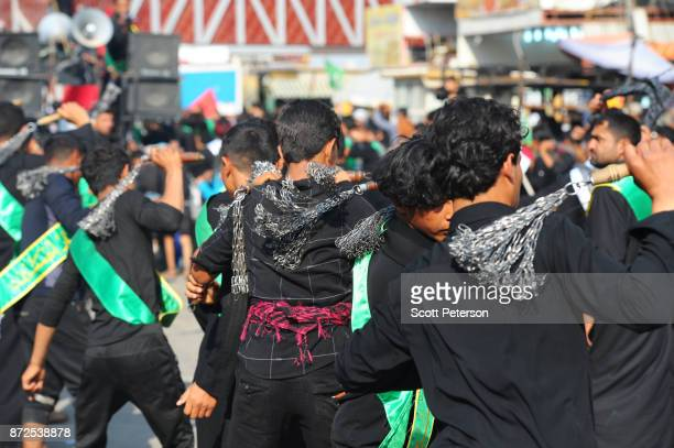 Shiite pilgrims flagellate themselves with chains as they march to the shrine of Imam Hossein to commemorate arbaeen, the fortieth day after the...