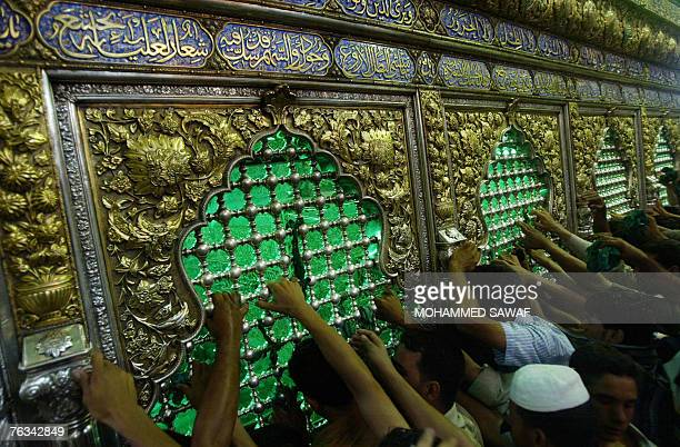 Shiite pilgrims gather around the tomb of Imam Abass ahead of celebrations marking the anniversary of the birth of Mohammed alMahdi the 12th Imam of...
