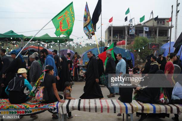 Shiite pilgrims march with flags from Baghdad to the shrine of Imam Hossein to commemorate arbaeen the fortieth day after the anniversary of the...