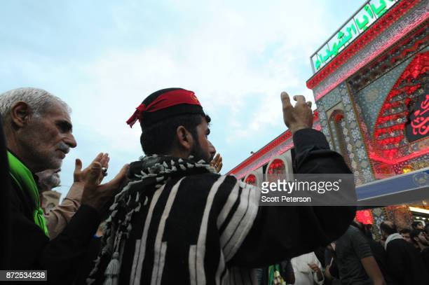Shiite pilgrims pray as they arrive at the shrine of Imam Hossein to commemorate arbaeen, the fortieth day after the anniversary of the 680AD death...
