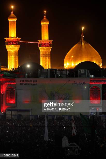 Shiite pilgrims take part in a ceremony at the Imam Hussein shrine in the southern Iraqi city of Karbala on September 19 on the eve of the tenth day...