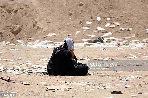 Shiite Turkmen families, fled Sinjar to enter the Baghdad, Karbala and Najaf, are kept waiting by Peshmerga forces at Hazer security checkpoint in...