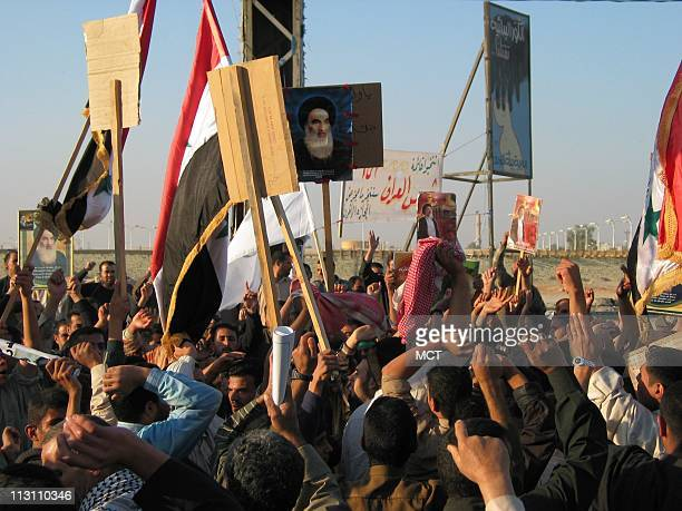 """Shiites on the streets of Najaf, Iraq, demonstrate in support of the religious leader Grand Ayatalloh Ali al Sistani, chanting,""""Death to Baathists,""""..."""
