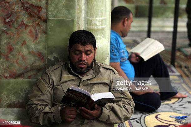 Shiites volunteers reads the Koran inside the AlAskari shrine which is under repair and embraces the tombs of the 10th and 11th Imams Ali AlHadi his...