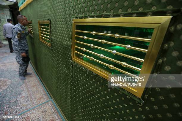 Shiites volunteers roam and pray inside the AlAskari shrine which is under repair and embraces the tombs of the 10th and 11th Imams Ali AlHadi his...