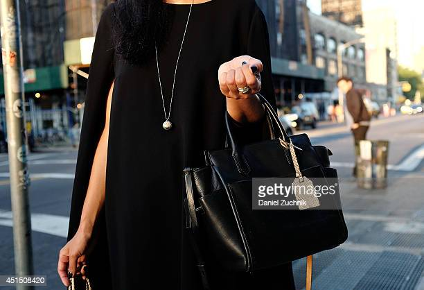 Shika Kimura is seen around Nolita wearing a DKNY dress Reed Krakoff bag and a Swarovski necklace on June 30 2014 in New York City