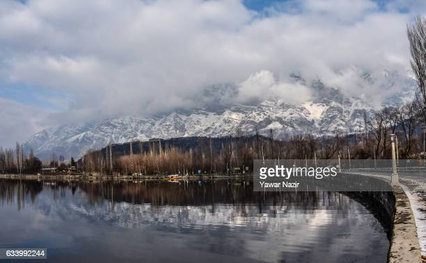 Shikara boats are moored the bank of Dal lake next to the snow clad mountains in Dal Lake on February 06 2017 in Srinagar the summer capital of...
