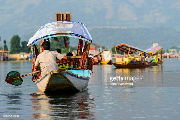SRINAGAR JAMMU KASHMIR INDIA Shikaras are the most common form of transportation for people and goods on Dal Lake Houseboats for rent and more...