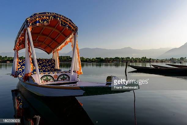 SRINAGAR JAMMU KASHMIR INDIA Shikaras are the most common form of transportation for people and goods on Dal Lake Houseboats for rent are seen in the...