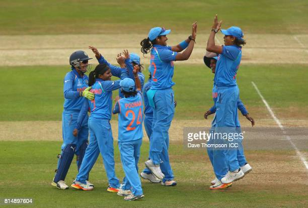 Shikha Pandey of India and Jhulan Goswami of India celebrate with team mates after taking the wicket of Lea Tahuhu of New Zealand during the ICC...