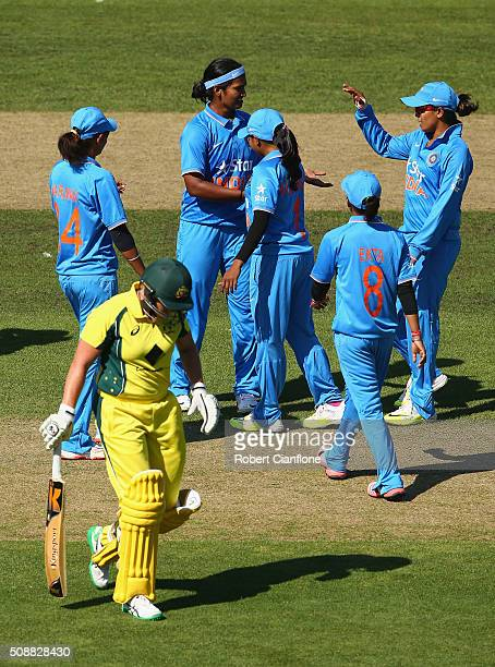 Shikha Pandey of India celebrates after taking the wicket of Grace Harris of Australia during game three of the one day international series between...