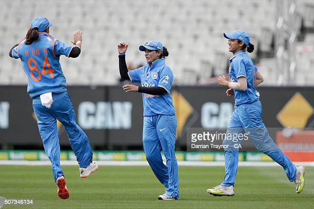 Shikha Pandey of India celebrates with team mates the dismissal of Sarah Coyte of Australia during the women's Twenty20 International match between...