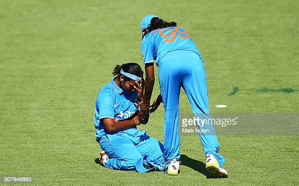 Shikha Pandey of India reacts after dropping a cacth during game one of the Women's ODI series between Australia and India at Manuka Oval on February...